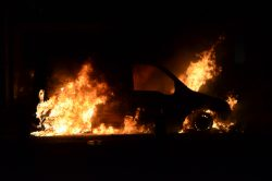 Burning_car_after_Manchester_riots[1]